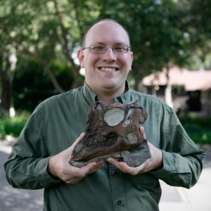 Dr. Andy Farke stands with the skull of Dinosaur Joe, the baby Parasaurolophus.