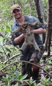Past Time guest Ryan Haupt holds a sloth in a Panama jungle